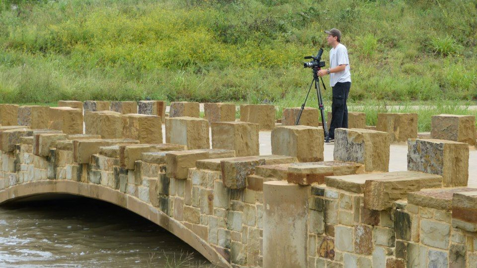 Mark Stitzer filming raging waters of San Antonio River after an all night rainstorm. 9/29/12
