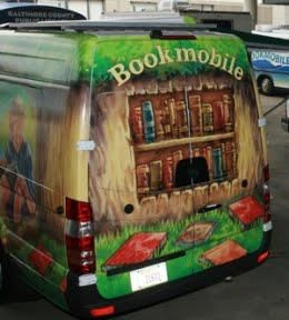 Bookmobiles on Parade (see the other bookmobile in the background?)