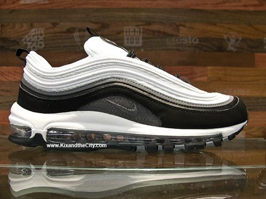 The Nike Air Max 97 Is Seen Here In A Black Cool Grey And White Colorway Nike Air Max Nike Popular Sneakers