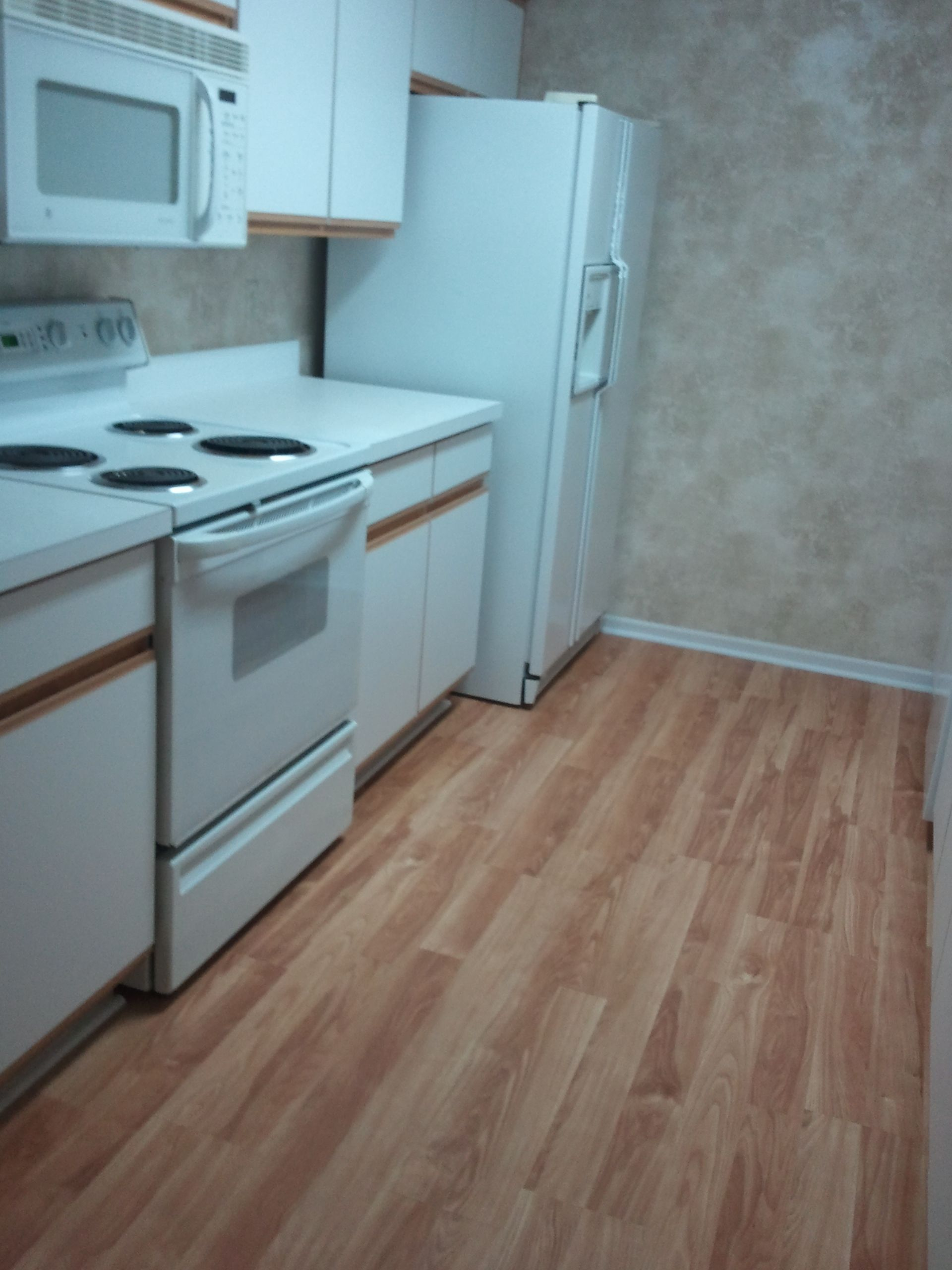 Preps Takes The Time To Install Flooring Under Kitchen Appliances A Detail Touch That Is Sure To Impress Buyers Floor Installation Pergo Flooring Flooring
