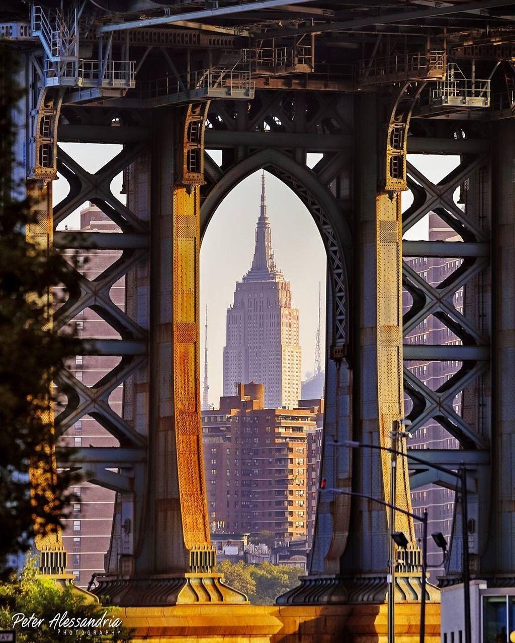 Empire State Building Through Manhattan Bridge By Peter