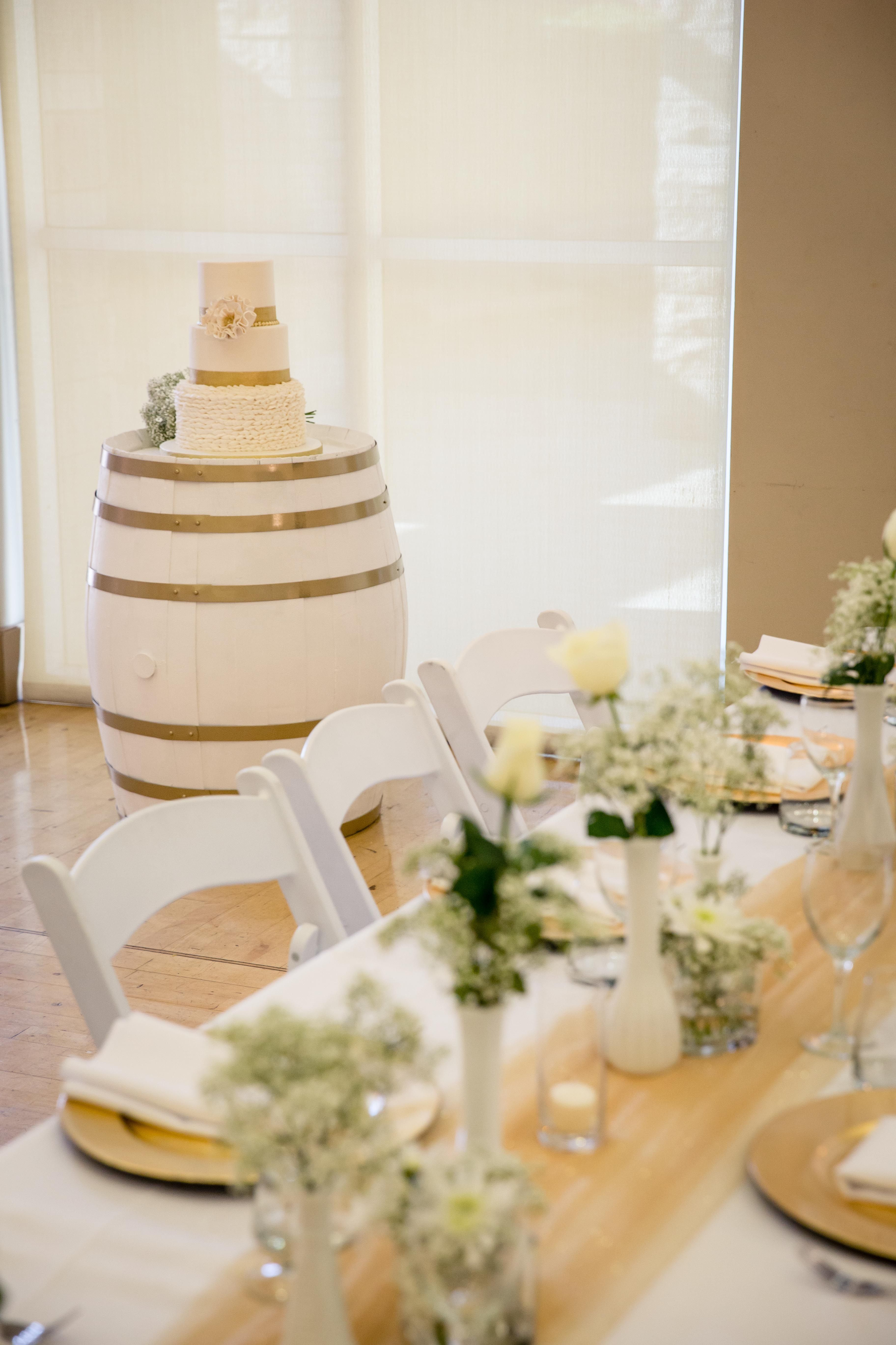 custom wine barrel cake table and DIY gold glitter tulle runner with ...