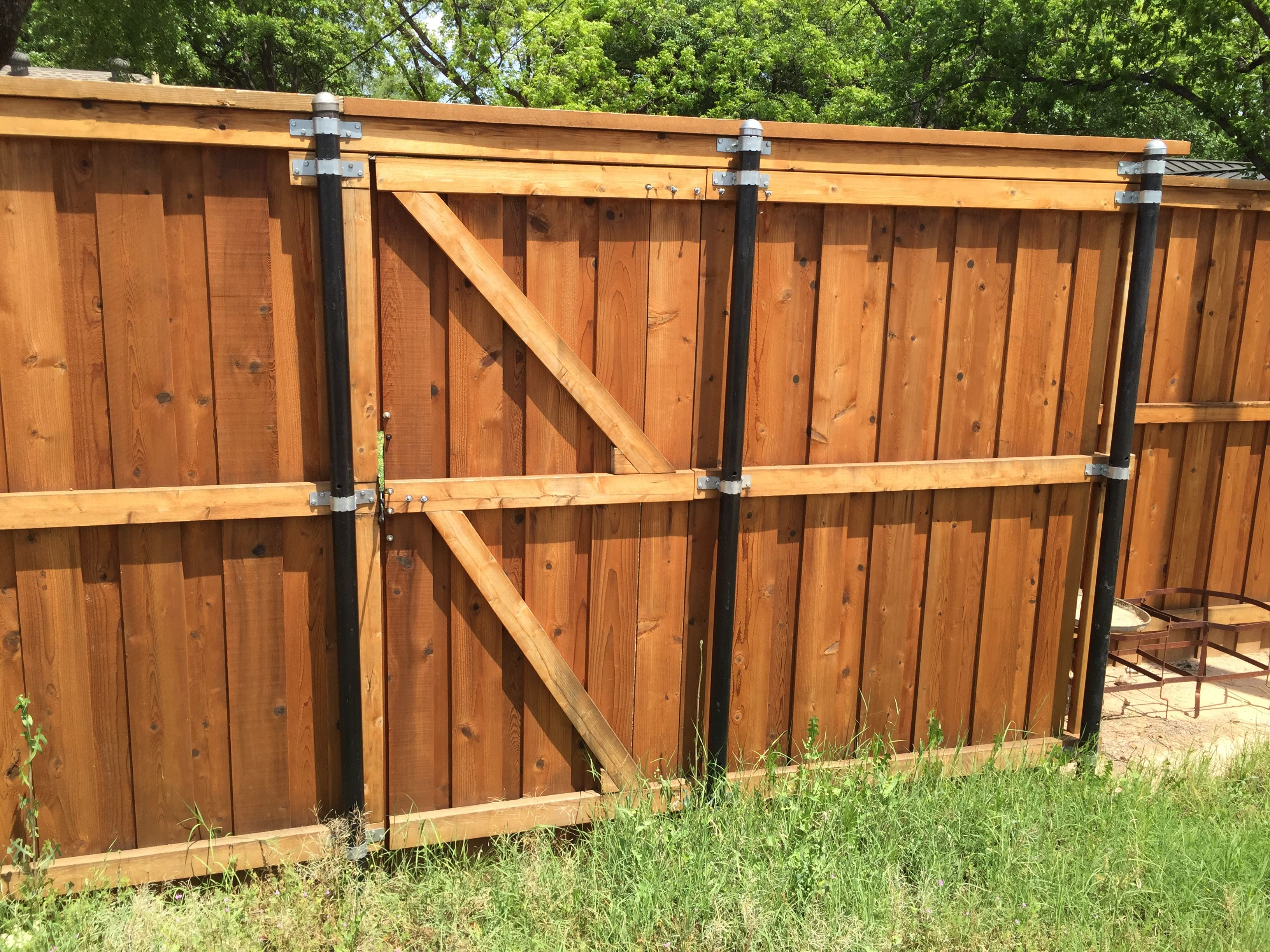 Stabilize Wood Fences With Metal Poles Wood Fence Stabilized