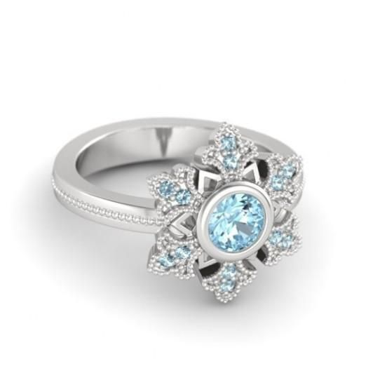 Disney Frozen Elsas snowflake wedding rings with aquamarine diamond