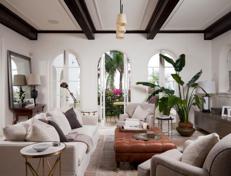 living room in spanish ottomans for the ultimate inspiration styling design exposed wooden beams a