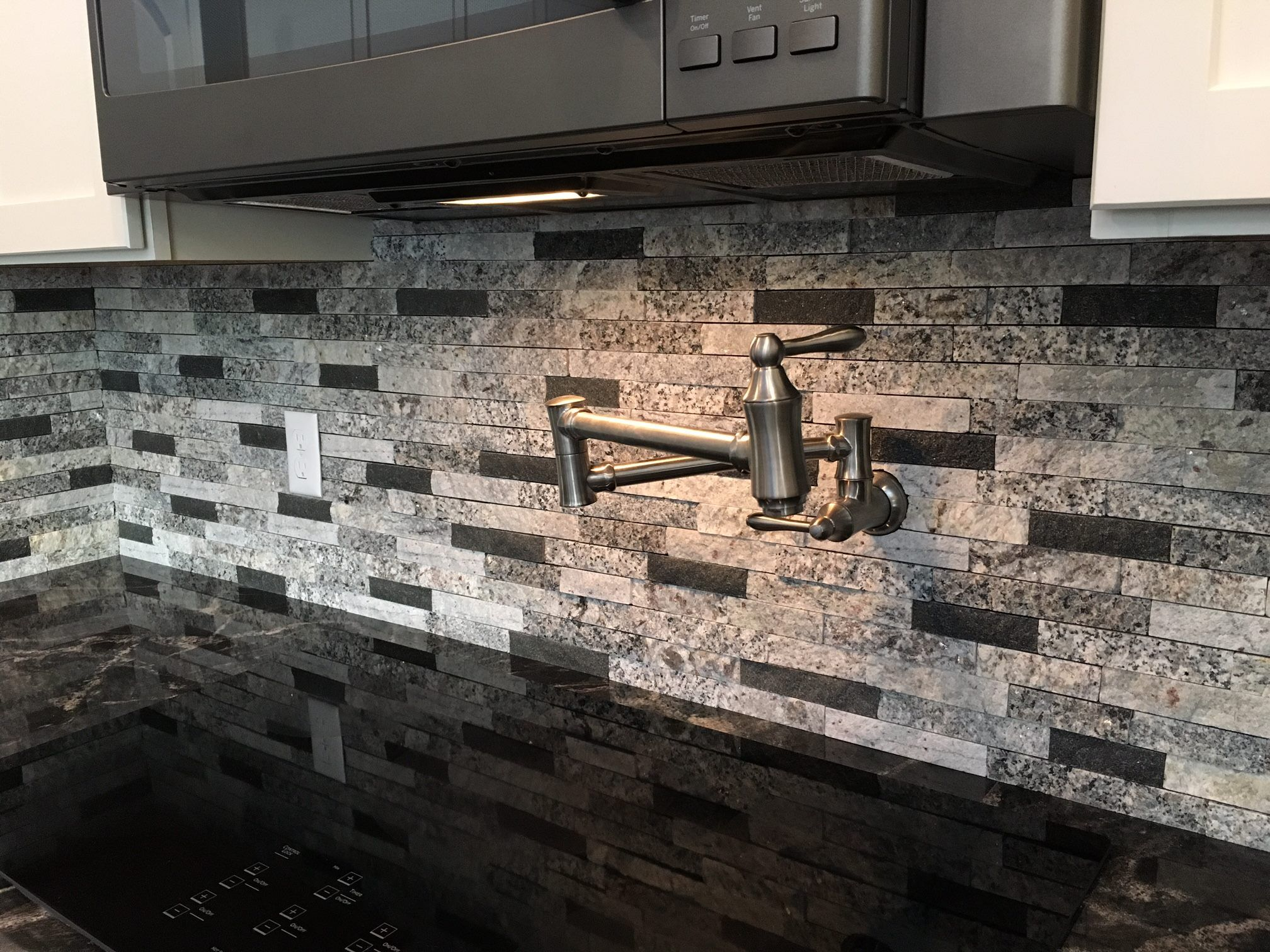 Charmant Recycled Granite Split Stone Tile In Our Shades Of Gray Blend With Black  Accents To Match The Black Granite Countertops. The Pot Filler Is Killer!