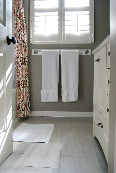 Gray budget bathroom remodel Love the floor and wall color