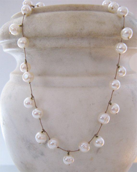 white pearls on tan silk cord