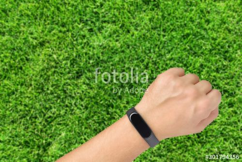 Hand with fitness or activity tracker on green grass background , #AFFILIATE, #activity, #fitness, #...