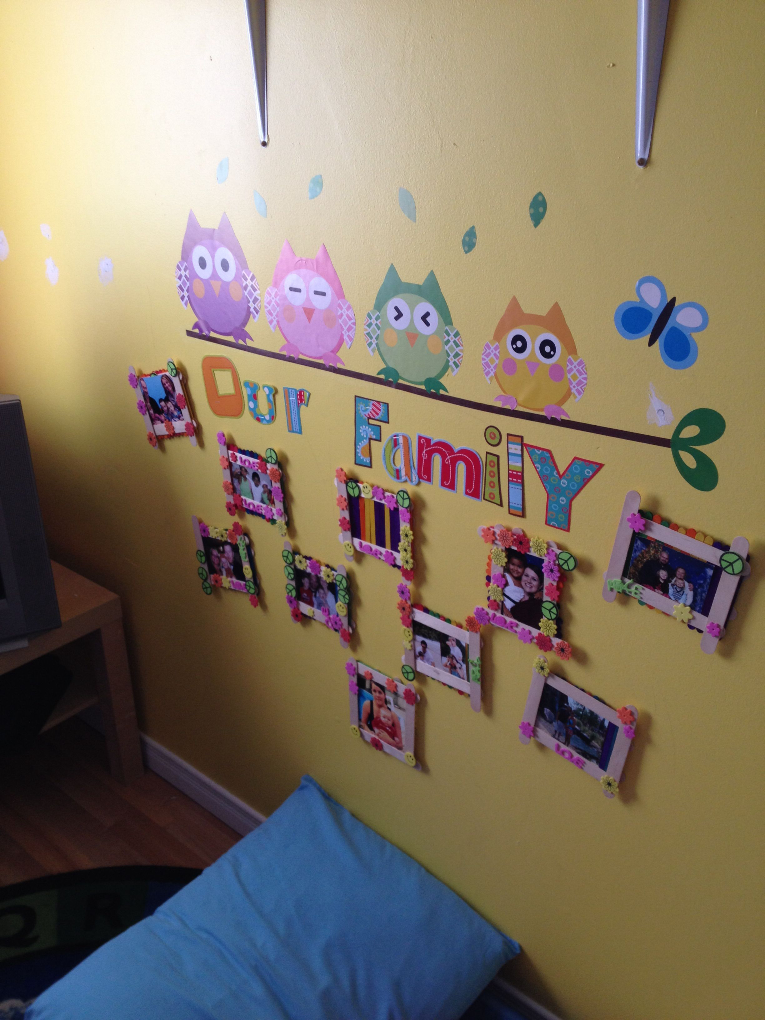 Toddler Classroom Wall Decorations ~ Family photos wall at daycare so the kids can see their