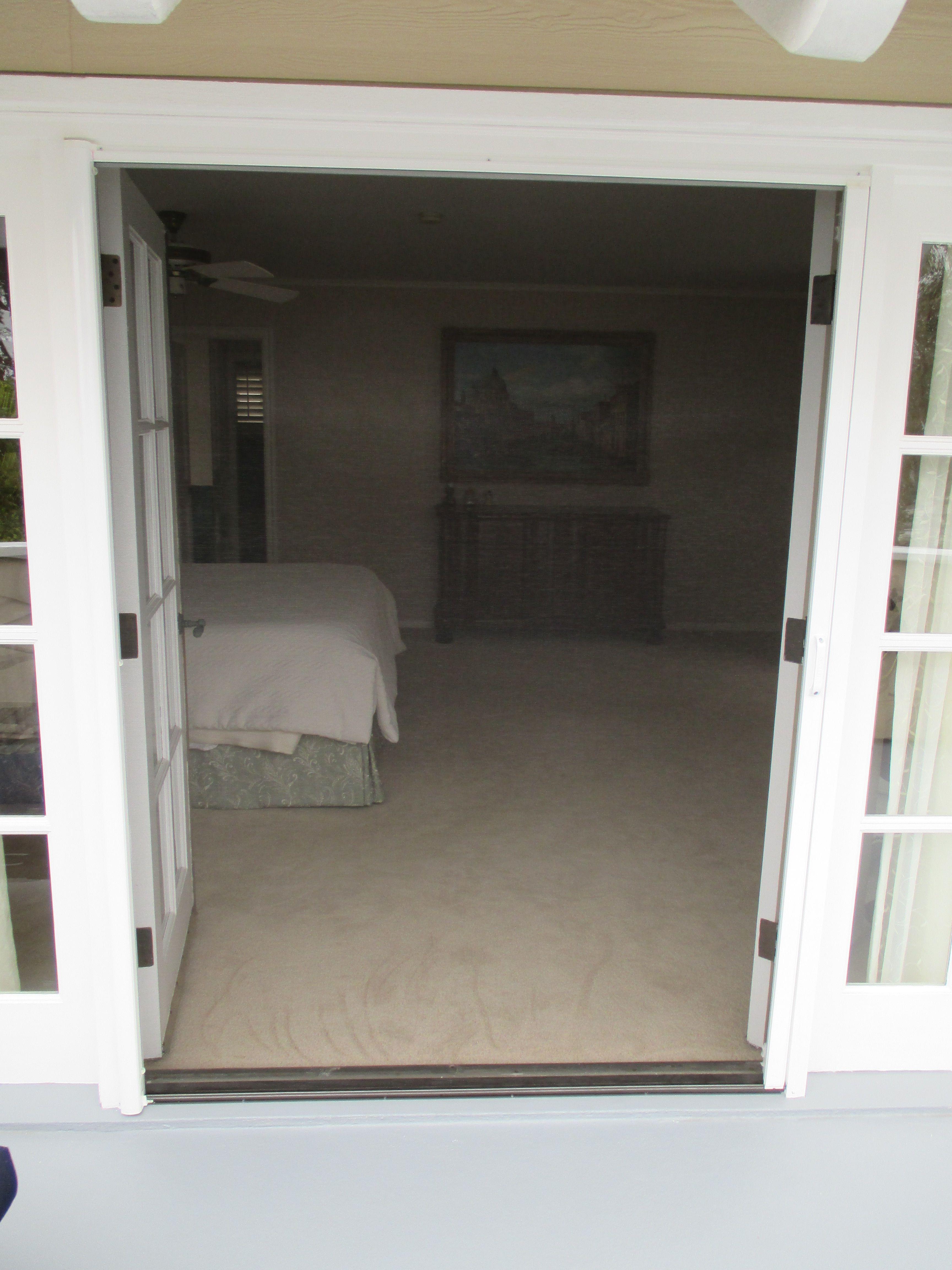 double door open. Single StowAway Retractable Screen Door Pulled Across A Double Door. That Is Correct...a 60\ Open