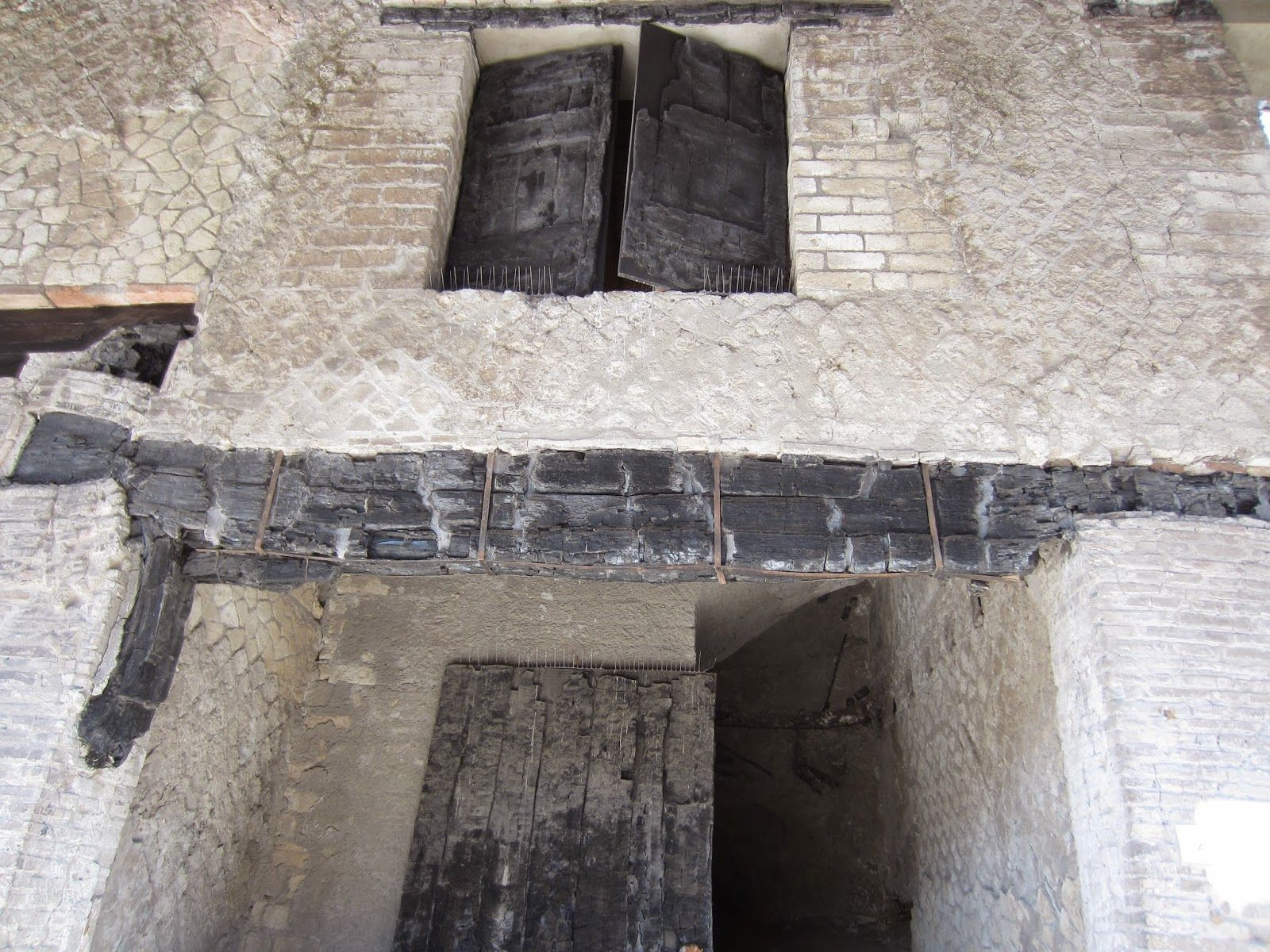 Herculaneum window, wood, give some idea of their methods of construction. The volcanic eruption acted in such a way as to preserve some of the original wood