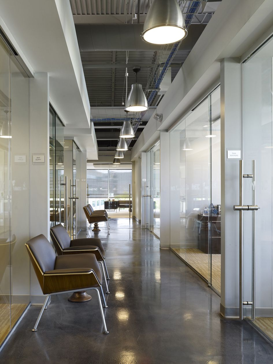 Corridor flooring different than offices herman miller for Funky office designs