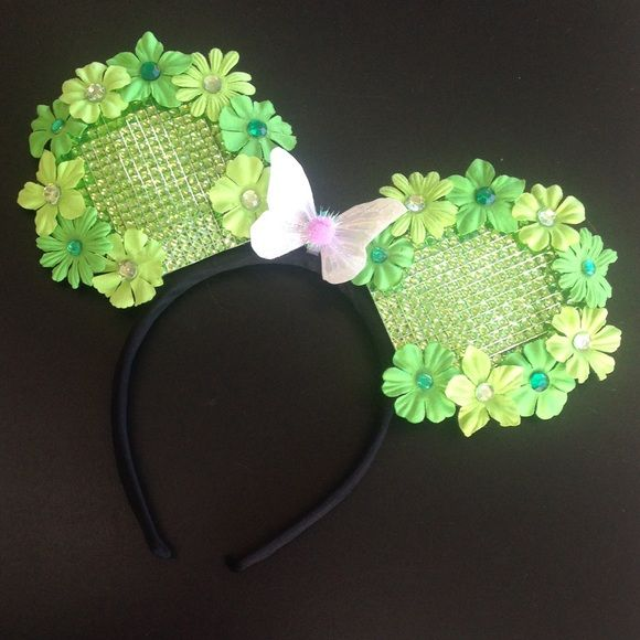 Custom Made Tinkerbell Minnie Ears Hand crafted and custom made, these Tink inspired Minnie ears are a must have to show off your inner pixie! Perfectly sparkly and sassy with rhinestones, flowers and fairy wings! This pair is available for purchase, and I also take custom orders Accessories Hair Accessories