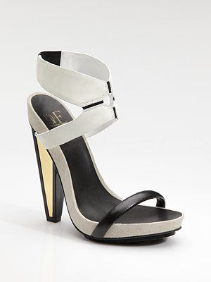 aren't these interesting? i like the mirror detail on the heel. dvf.
