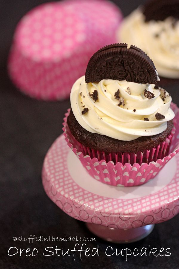 OMG this easy Oreo Stuffed Cupcake just uses three things ... chocolate cake mix, vanilla frosting and oreos.