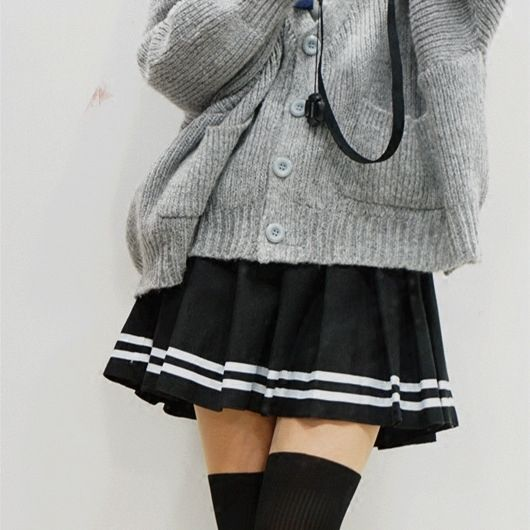 f348a03c09 Grey cardigan, black pleated mini skirt, over the knee socks