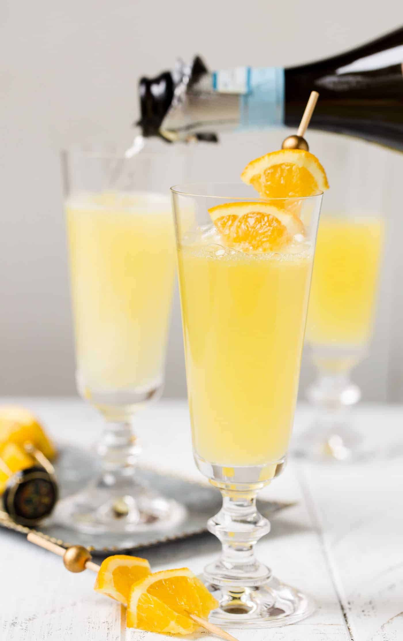 One Sip Of This Grand Orange Mimosa Recipe And You Ll Never Drink A Plain One Again Mimosa Brunch Prosecco Cocktails Mimosa Recipe Prosecco Cocktails Easy