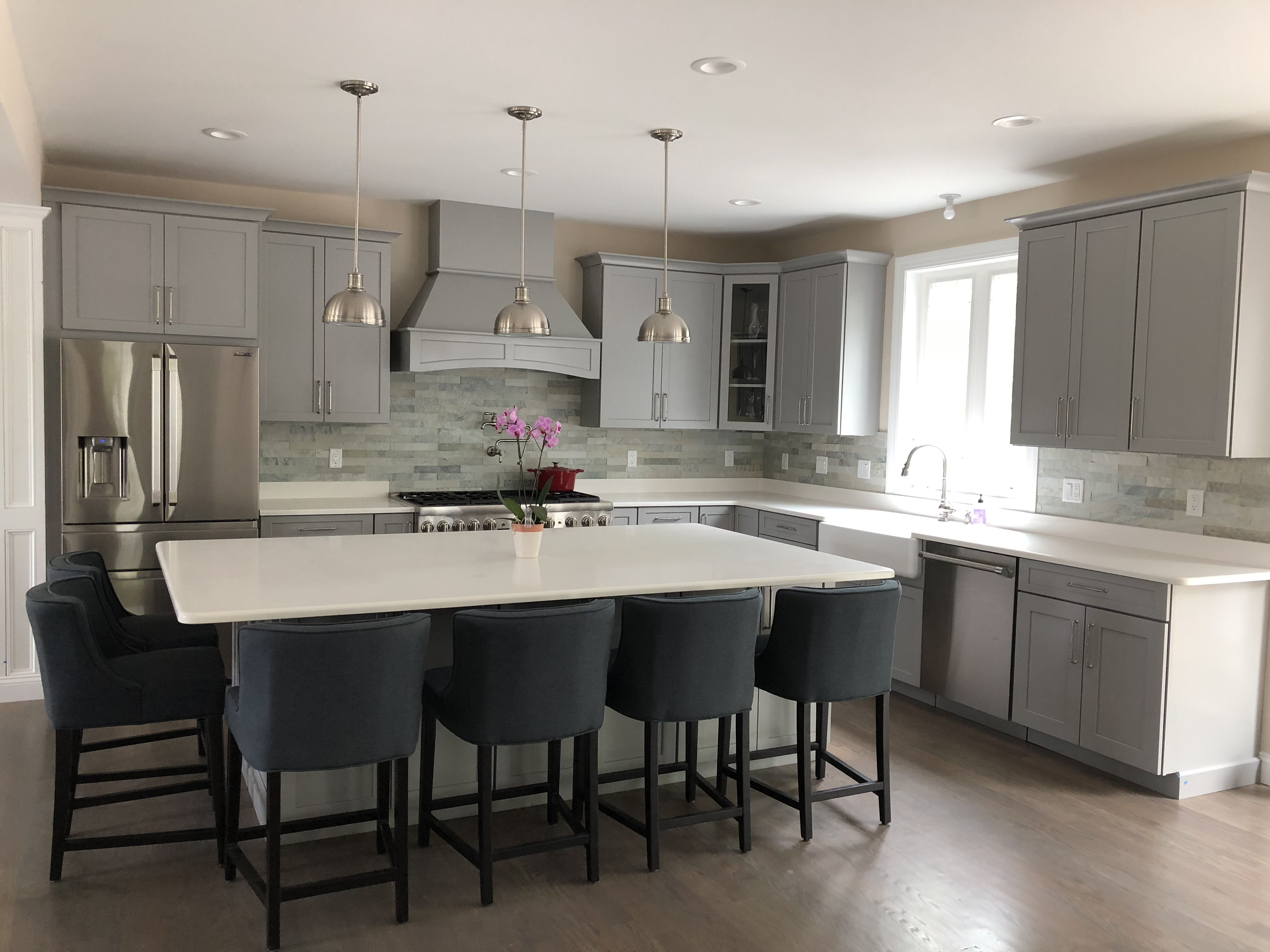 Gray Kitchen Cabinets With White Quartz Island And Countertops