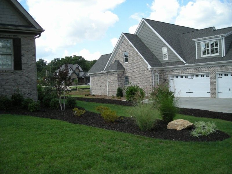 A Landscape Bed Easily Divides This Property Line And The Dark