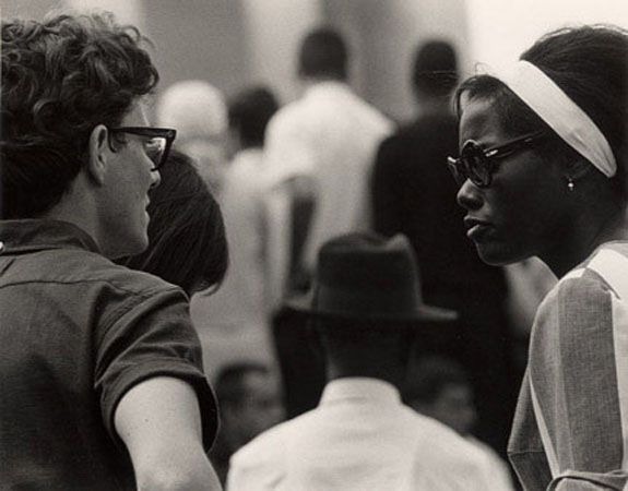 Check out http://decarava.org!  The Sherry and Roy DeCarava Archives holds and maintains the work and estate of Roy DeCarava  -   Marchers Talking.  1963