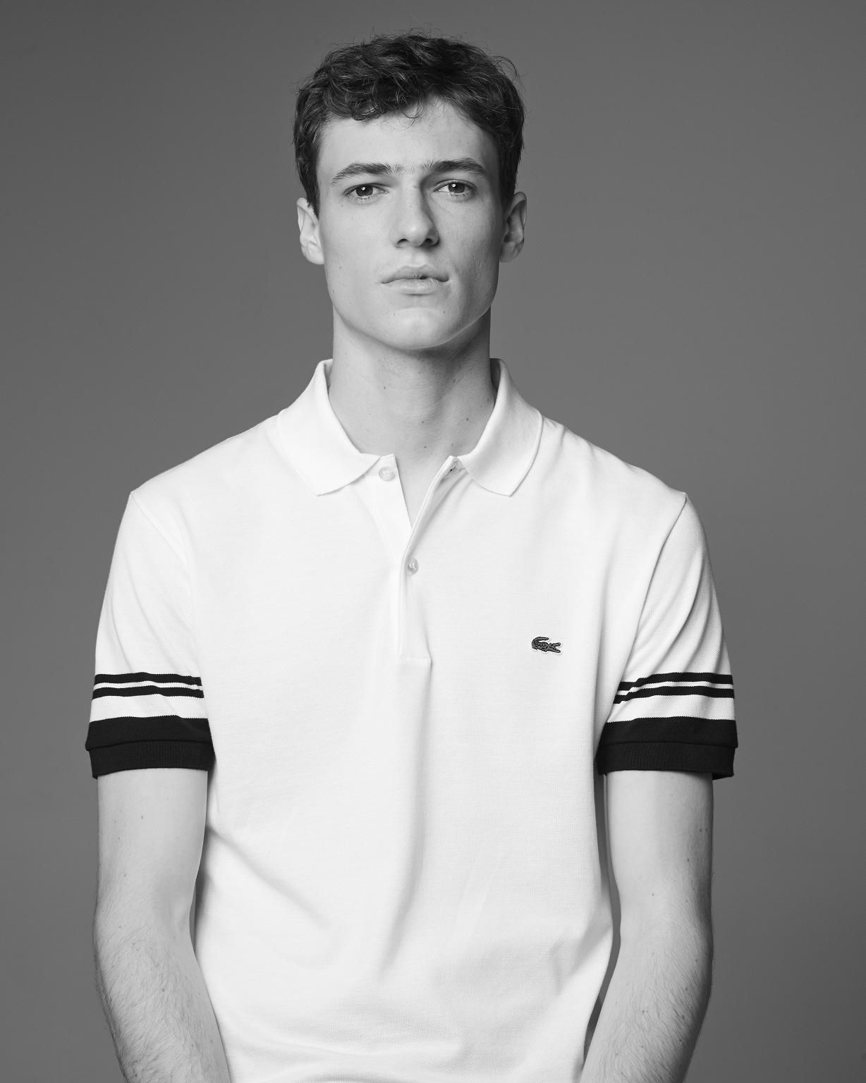 ce9c35cf1b The white and blue Slim Fit Polo with Striped Sleeves by Lacoste is ...