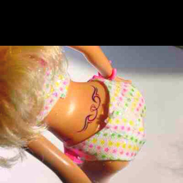 c0b4b63073112 Barbie with a tramp stamp! Hahaha   Stuff my Mom would LOVE   Barbie ...
