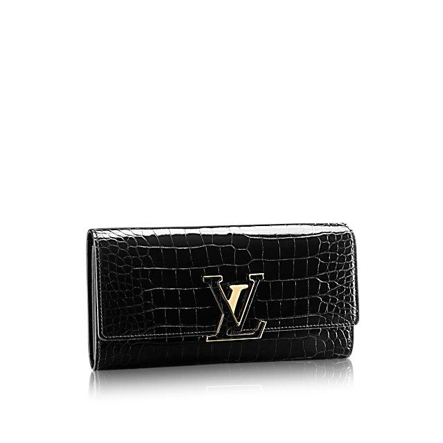 e5375ee5ce37 Discover Louis Vuitton Capucines Wallet  Crafted from precious alligator  leather with an alligator-covered LV signature