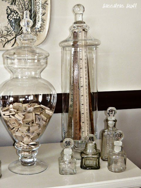 Tall Jar Full Of Rulers And Giant Apothecary Jar Filled