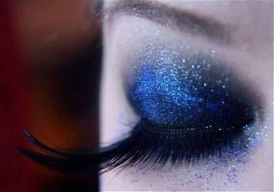 dark blue smoky eye with feather eyelashes