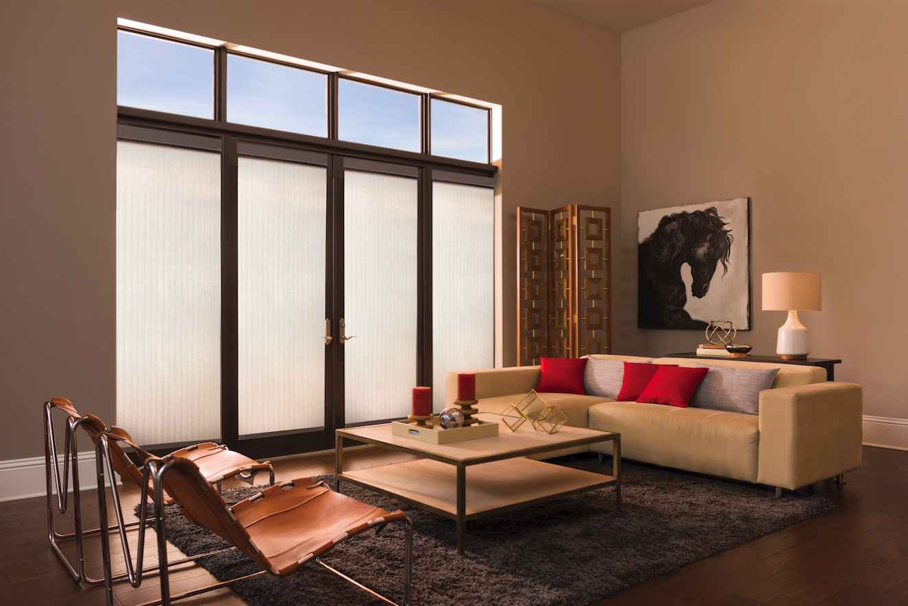 Champagne solar roller shades are an ideal option for covering doors