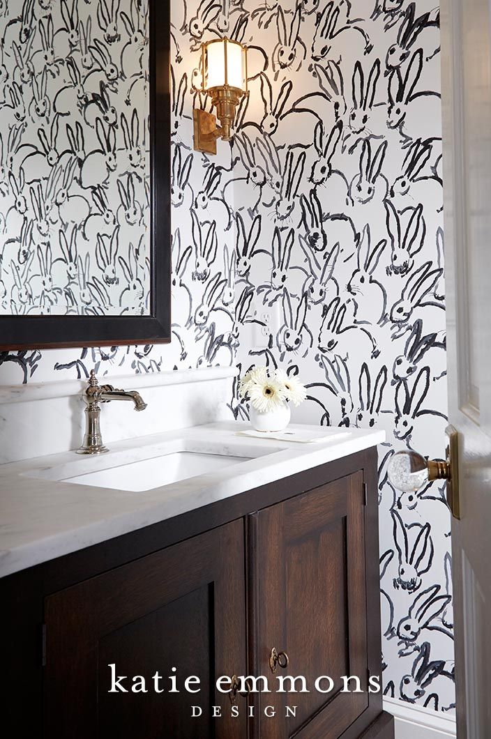 Fun Bathroom Design Featuring Gold Accents And Patterned Wallpaper