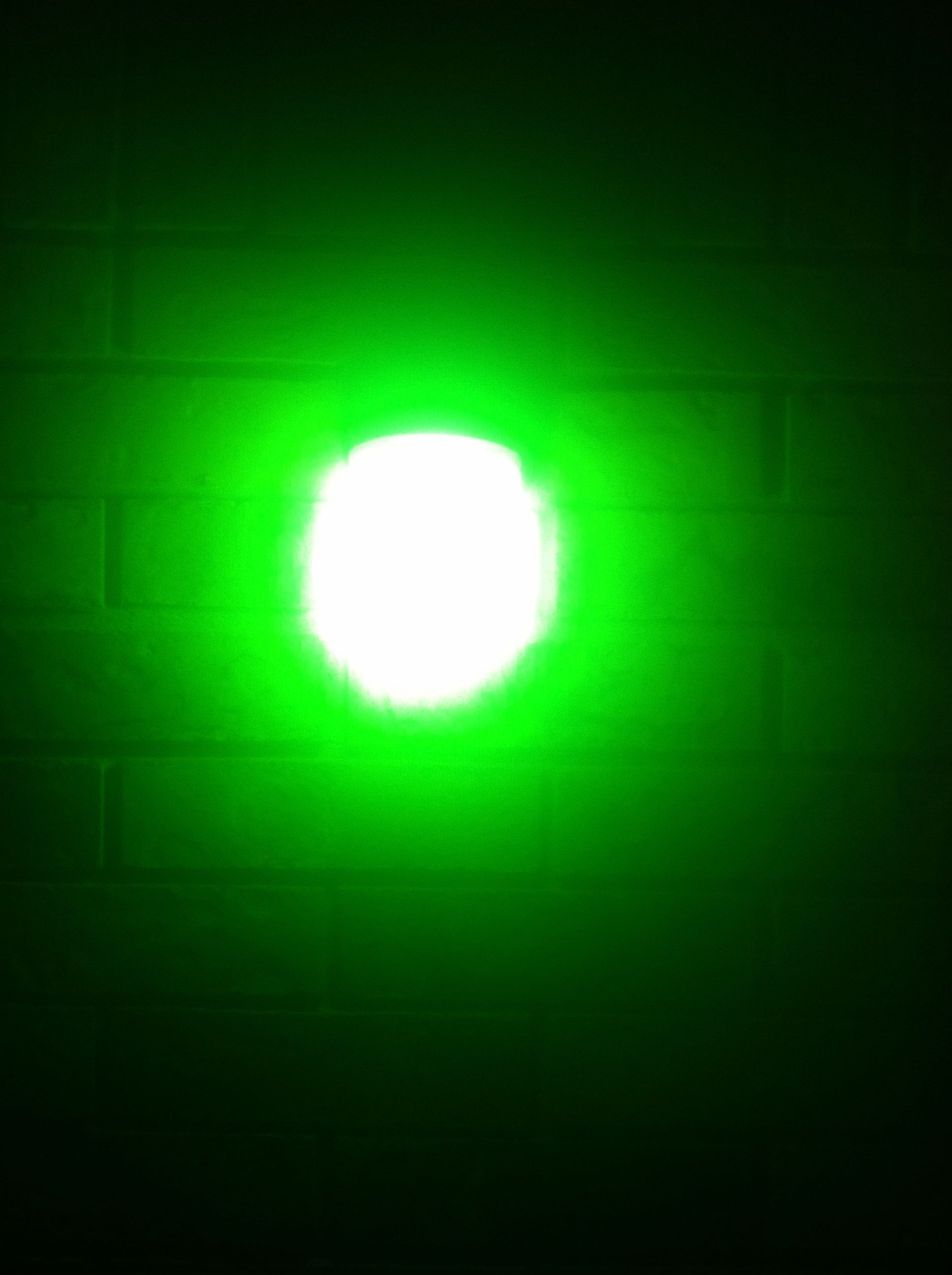 what does the green light symbolize in the great gatsby