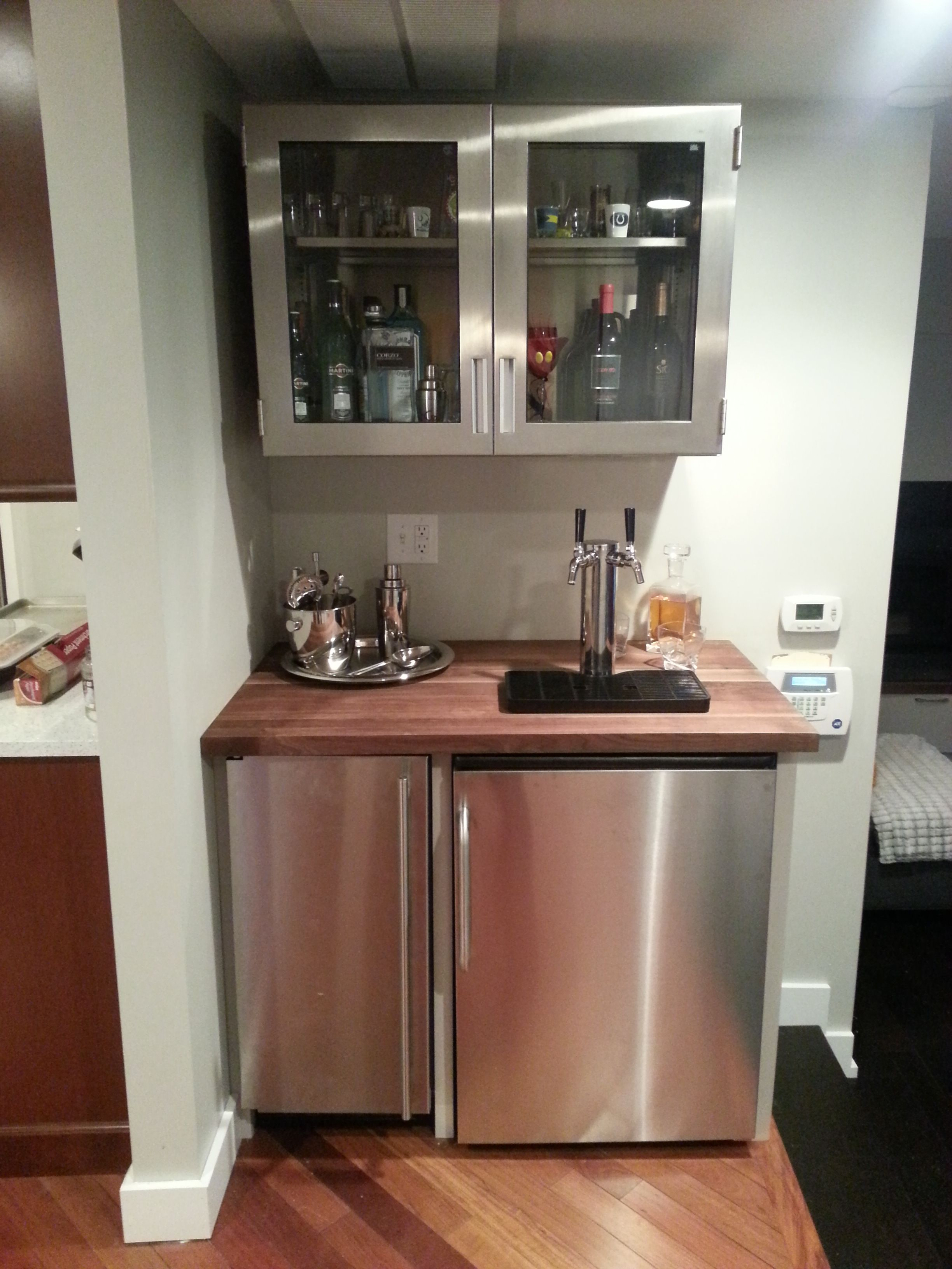 Bar with medical cabinet, kegerator and ice maker | Custom ...