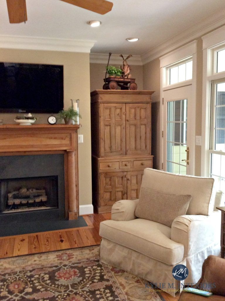 Lenox tan benjamin moore in warm farmhouse style living room with oak pine and wood fireplace kylie m interiors e design and online colour consulting