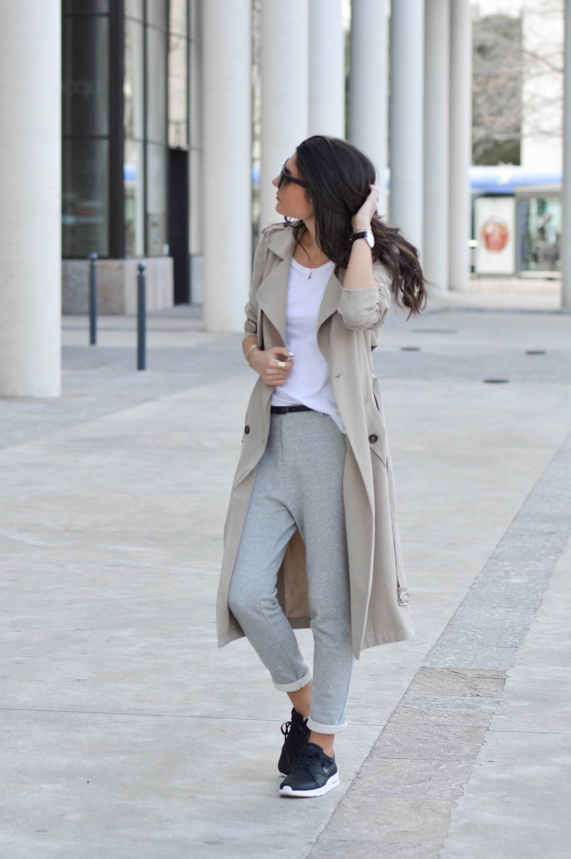 0667e51a4f9c Federica L. shows us exactly how to combine joggers and a trench coat by  creating a sophisticated yet innately casual style which we love! A plain  white tee ...