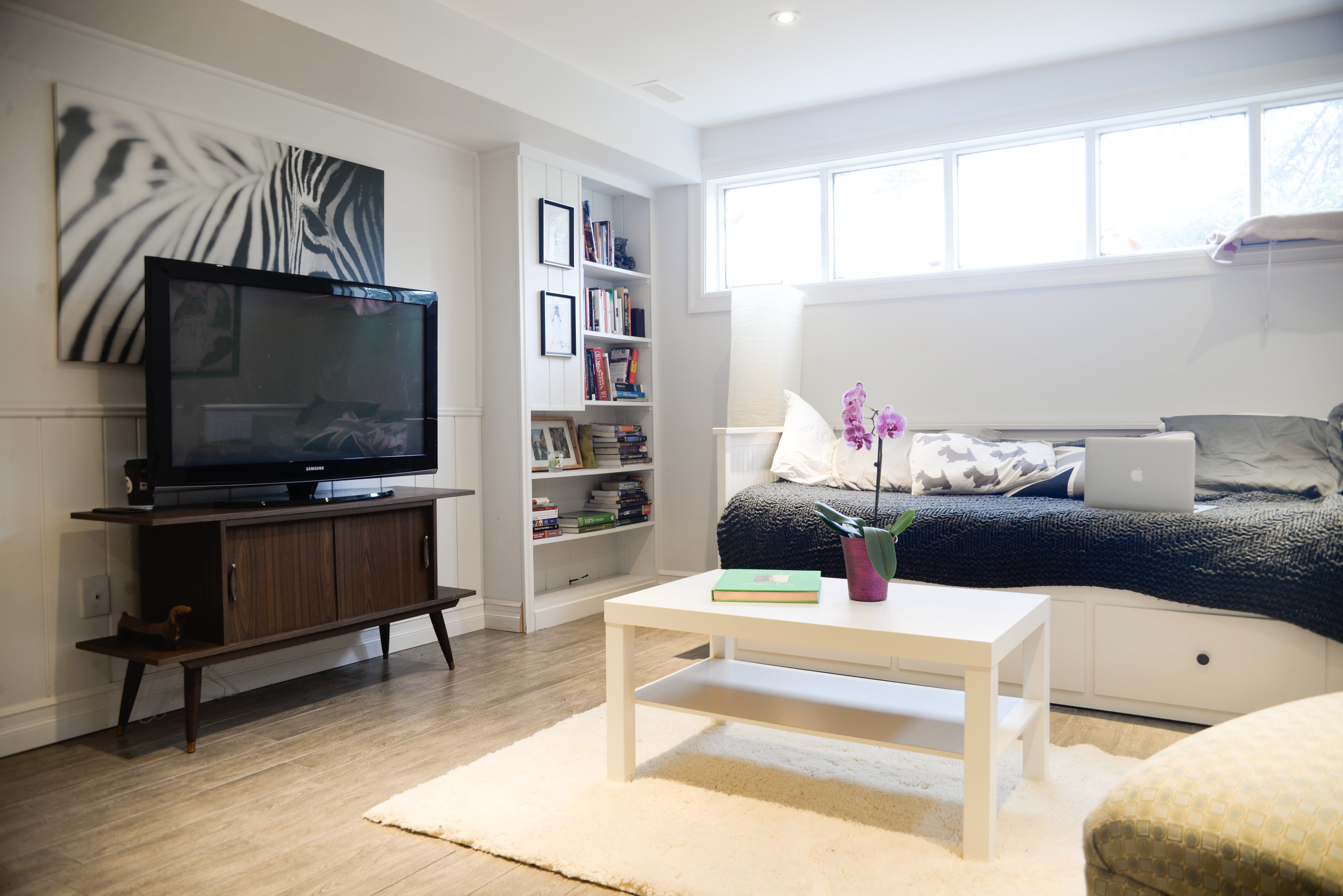 The Pros And Cons Of Renting Or Buying A Basement Apartment Basement Apartment Basement Studio Studio Apartment Decorating