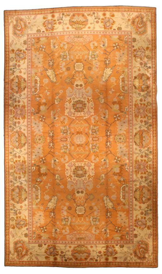 A Turkish Oushak rug Circa: 1920 An early 20th century Turkish Oushak (Ushak) rug, the rust field with a spacious symmetrical desi...