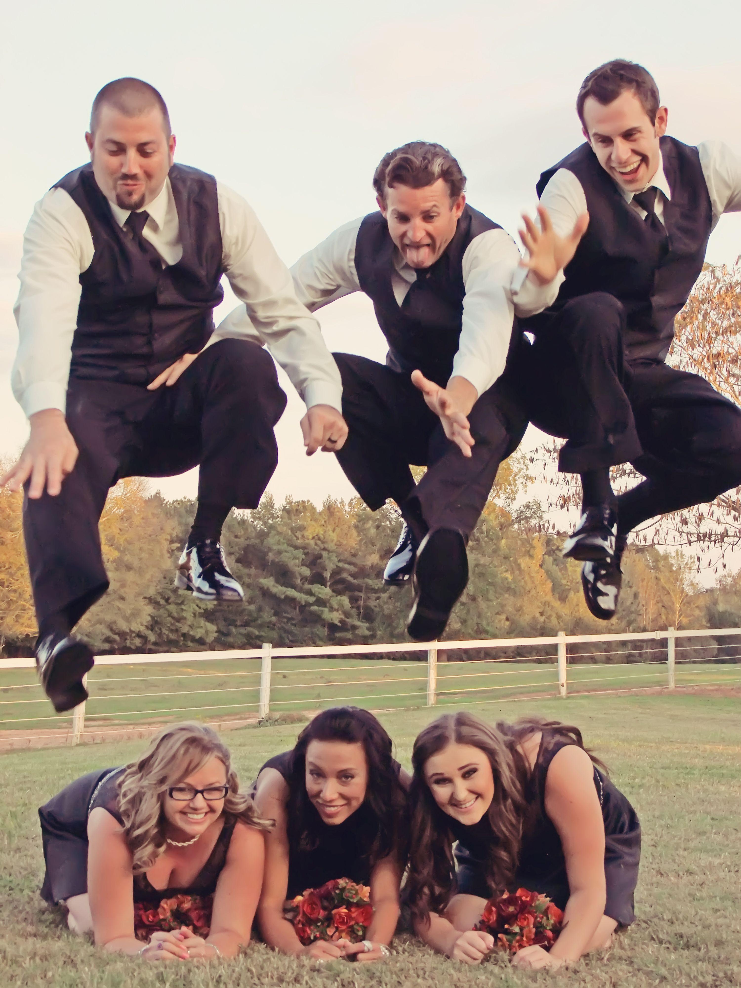 Groomsmen jumping over the bridesmaids! WWW.FOTABULOUSWEDDINGS.COM