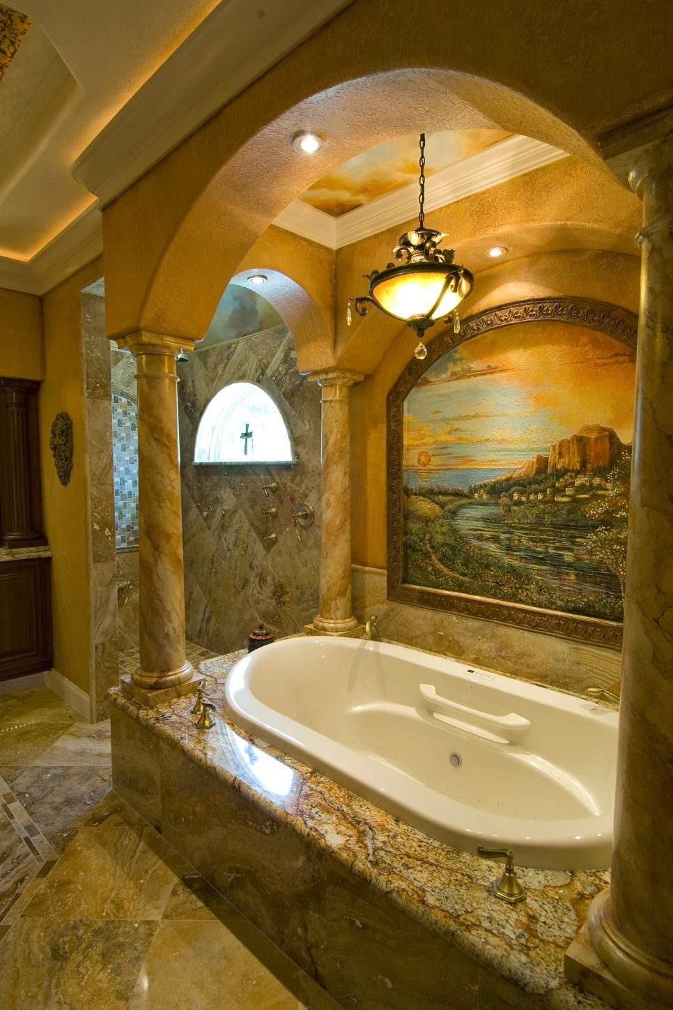 Stone columns connected with arches section off the bathtub in this ...