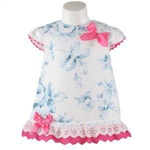Vaatteita tytöille. Miranda textilesin pinkki somisteinen kukkakuvioinen mekko tytölle. Vauvanvaatteita ja lastenvaatteita www.nellikki.fi
