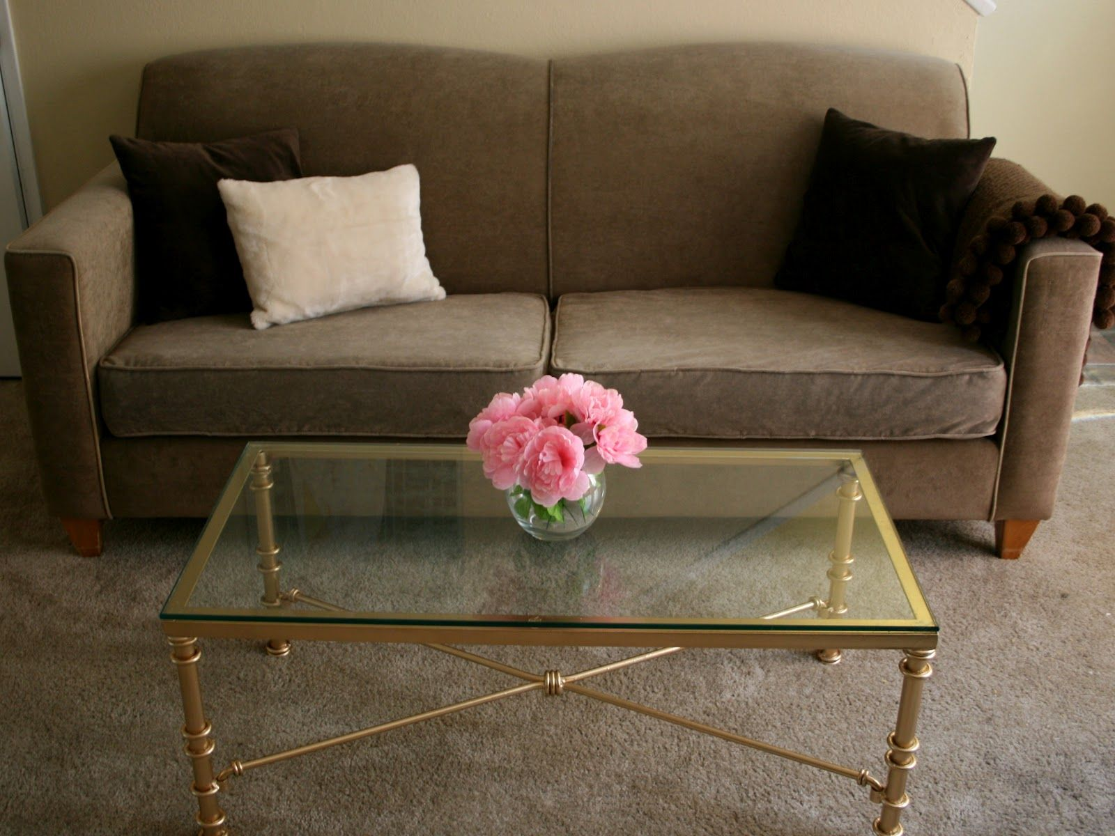 How I Made Over An Ugly Metal Coffee Table Into A Glam Gold Spray Painted  One