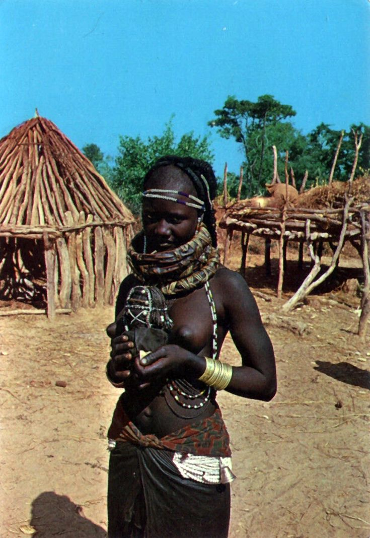 "Africa | ""Africa Portuguesa:  Mulia girl with ornaments."".  Dated July 1973.  