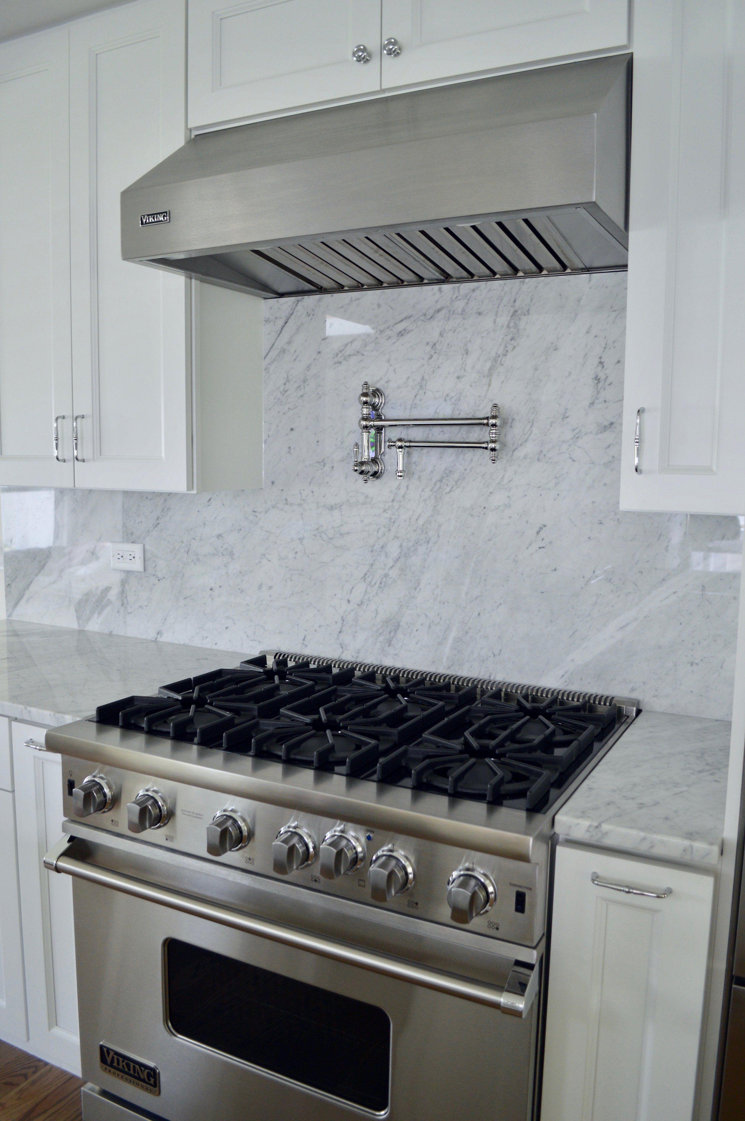 White Marble Backsplash With Pot Filler Galley Style Kitchen