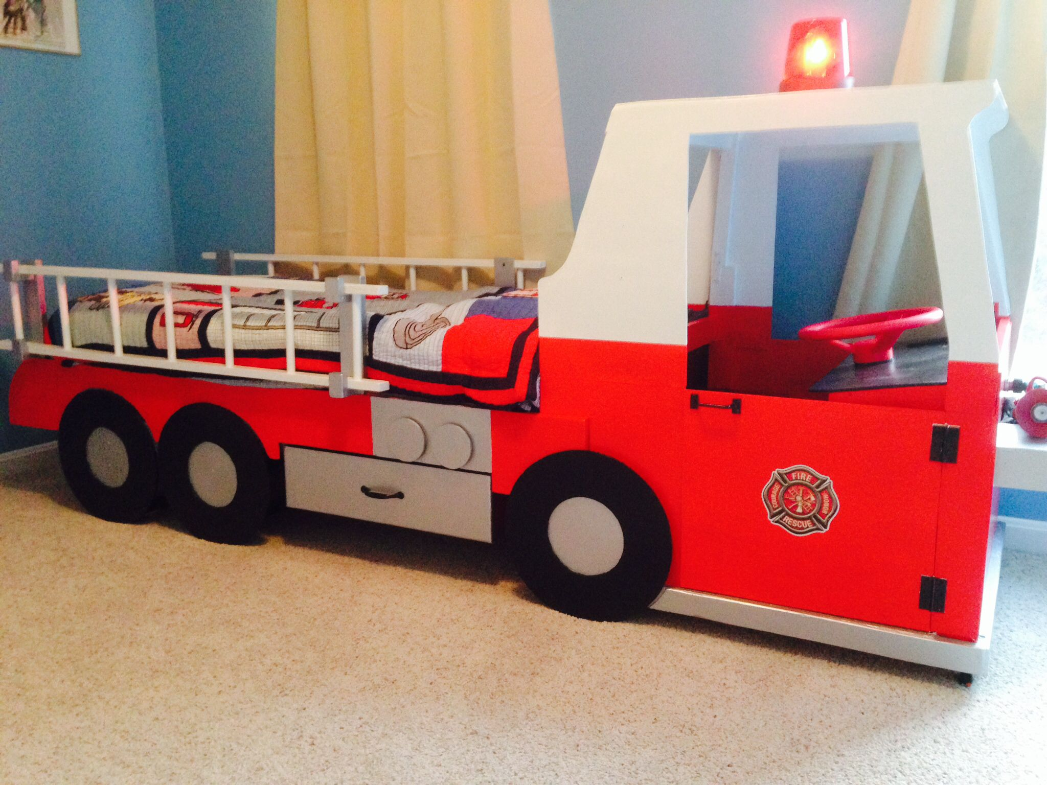 Fire Truck Bed For A Toddler My Husband Made This For Our 3 Year Old Steering Wheel And Working Siren Ligh Firetruck Bed Truck Toddler Bed Fire Truck Bedroom