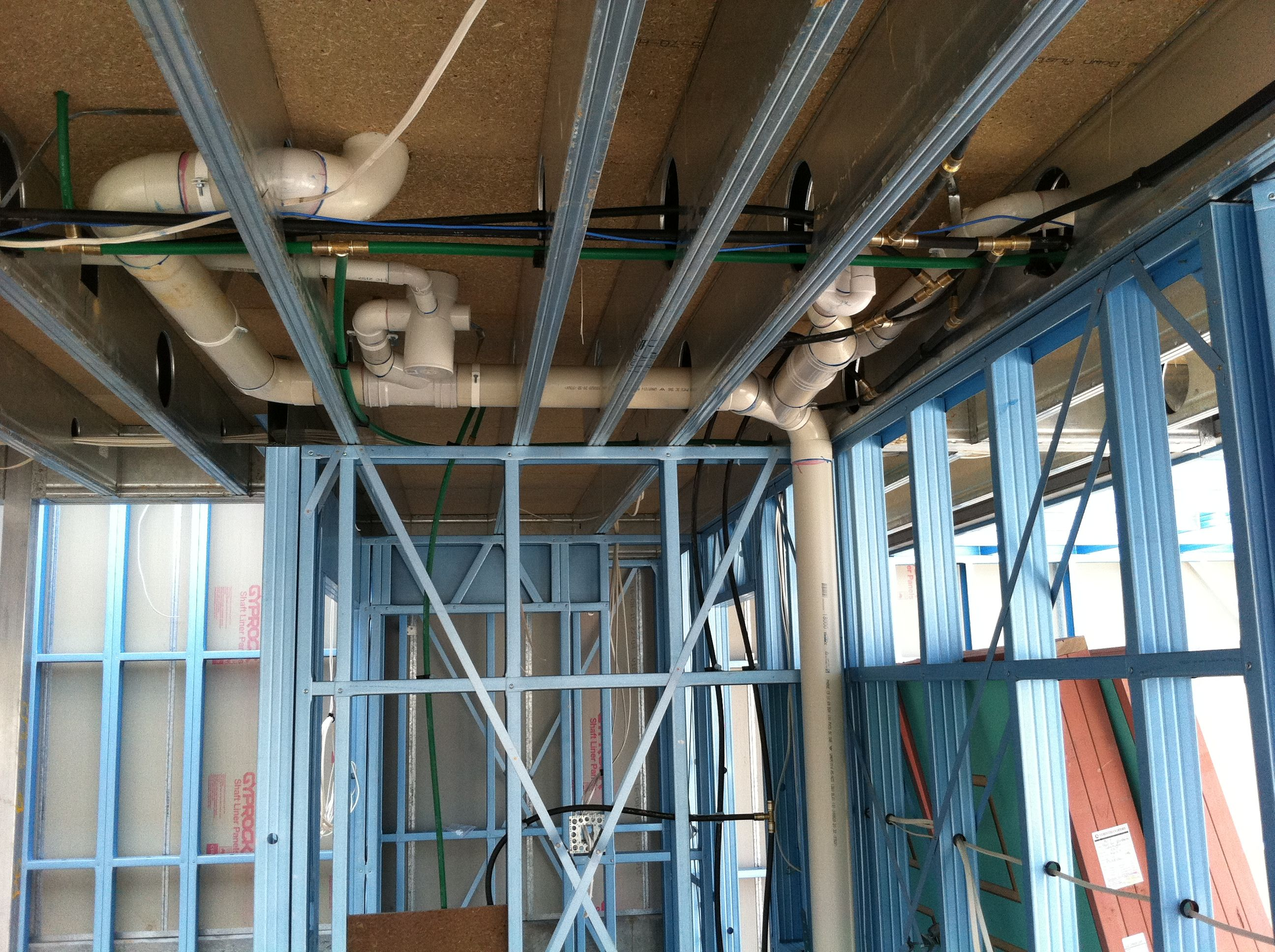 Boxspan Steel Upper Floor Frame- Plumbing has been installed within this  steel frame house.