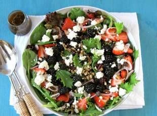 Juicy berries, creamy goat cheese and a toss of crisp spring mix makes Sherri Logan-Williams' Berry Berry Good Salad a picnic must.