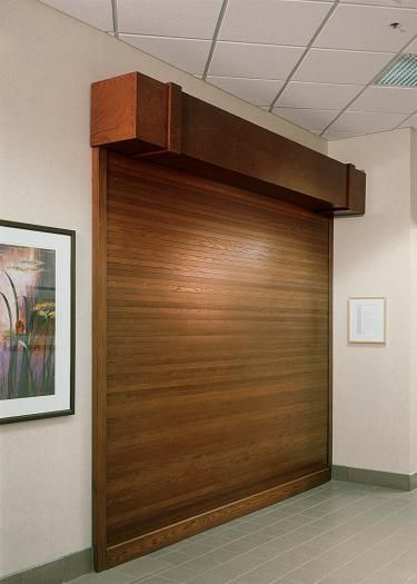 We Have The Largest Inventory Of Woodfold Accordion Custom Roll Up Doors.  Used For Commercial Use Such As Movie Studios, Banks And Hotels.