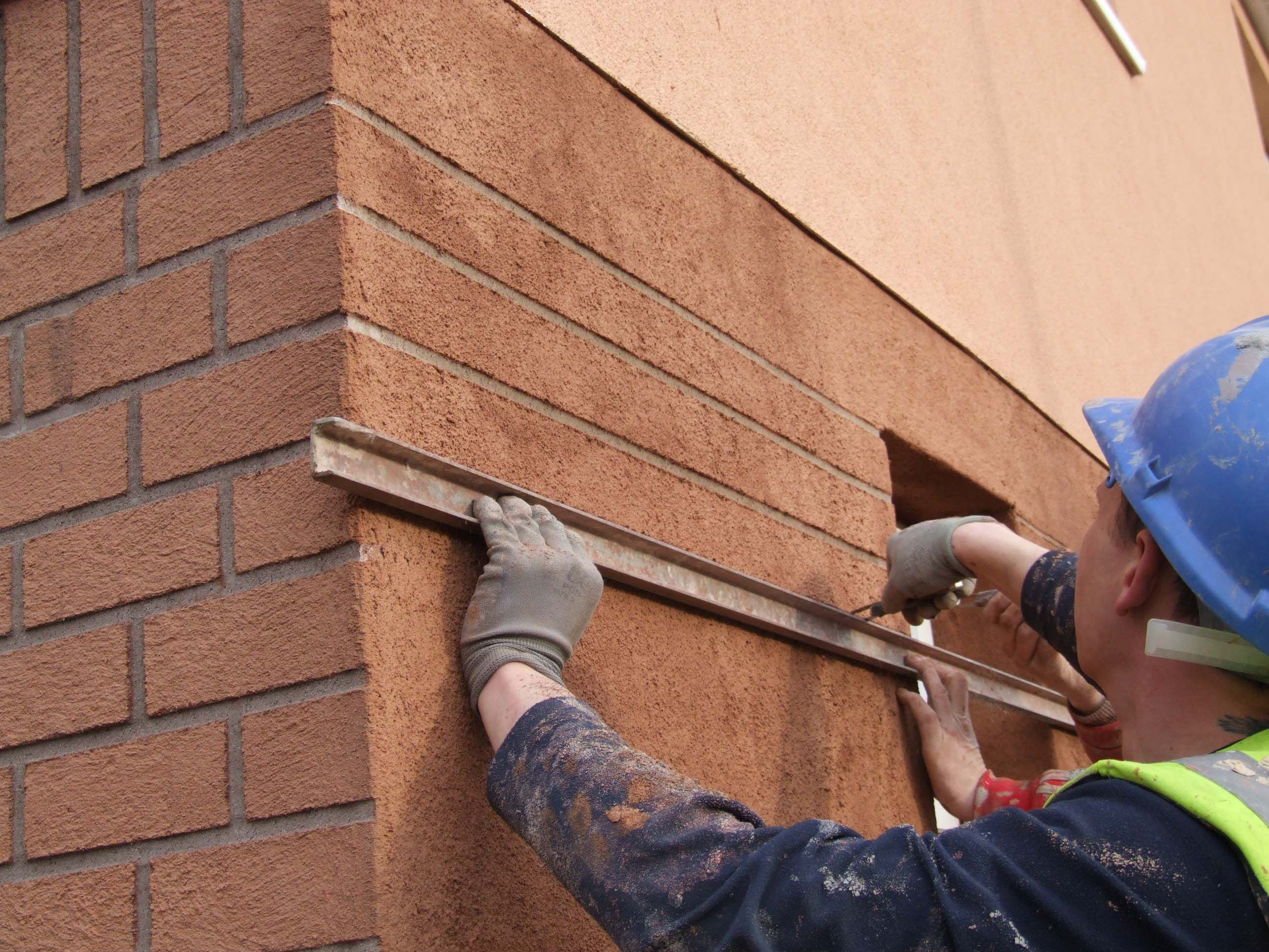render brick finish on external wall insulation to create a traditional brick finish to the facade