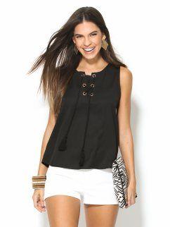 Blusa negra mujer sin mangas con ojales metálicos